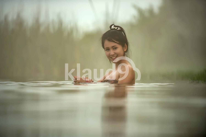 Pretty woman bathing in hot springs