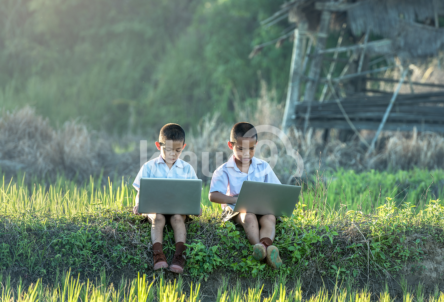 Two boys using a laptop