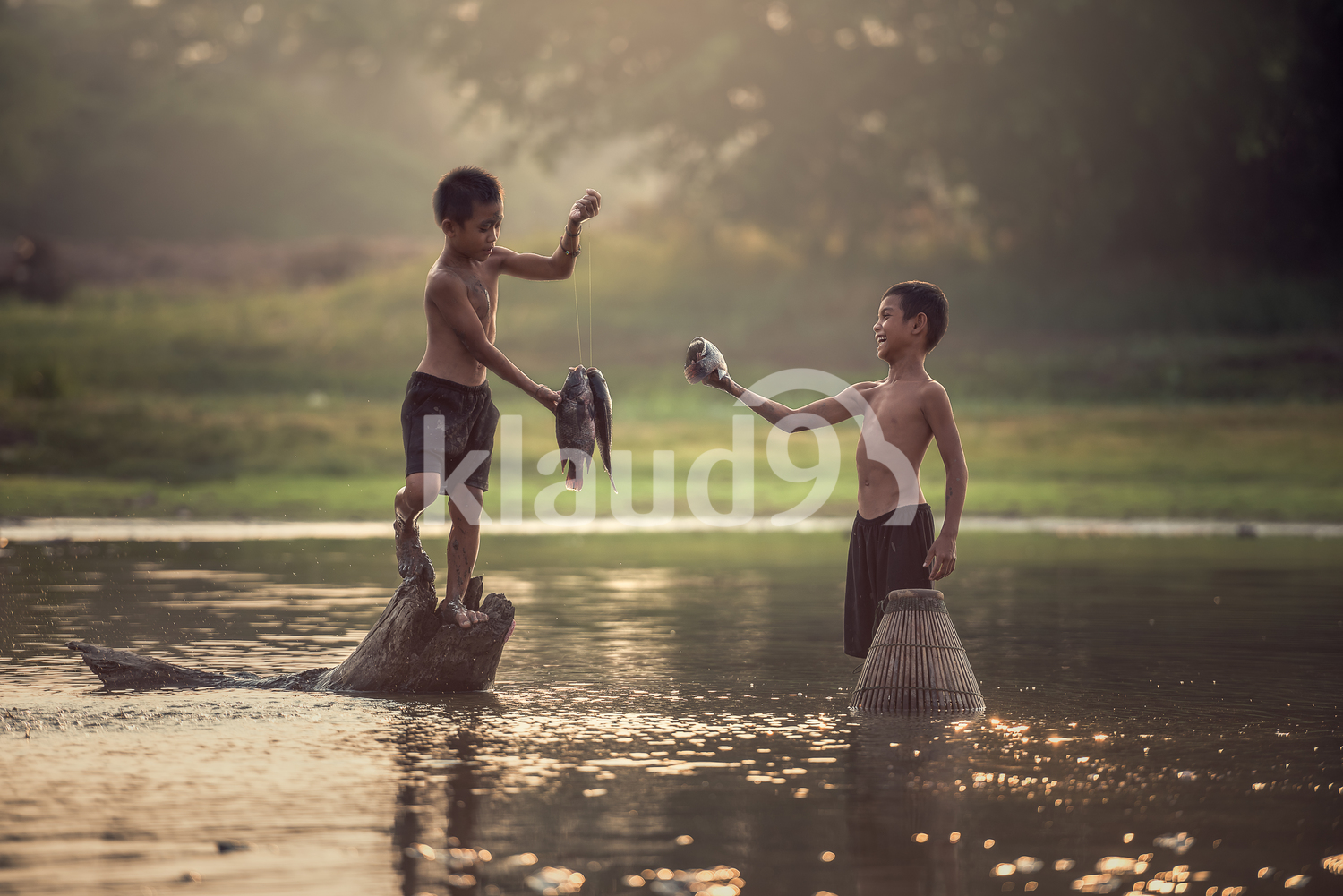 Asia boys fishing in the lake