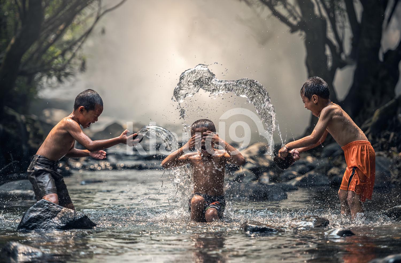 Three boys joyful with splashing