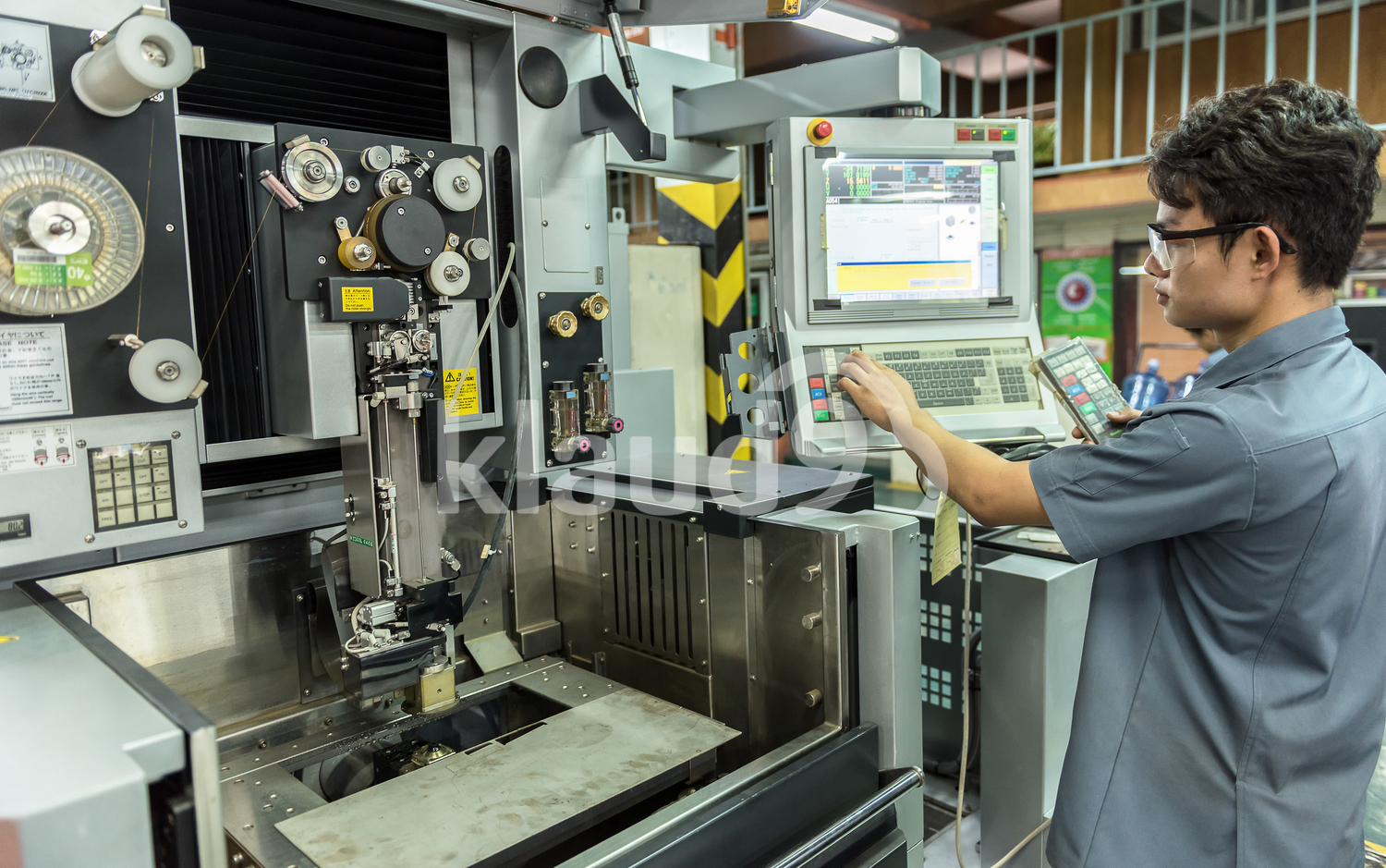 Worker working with cnc machine