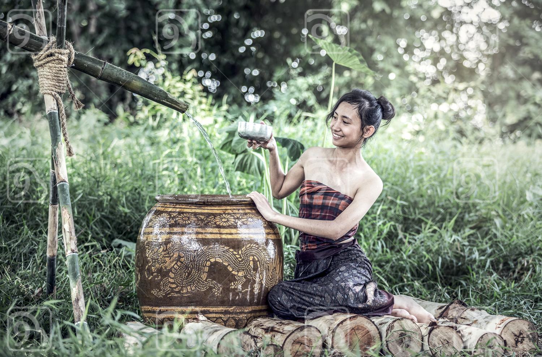 Young Asian Woman Bathing
