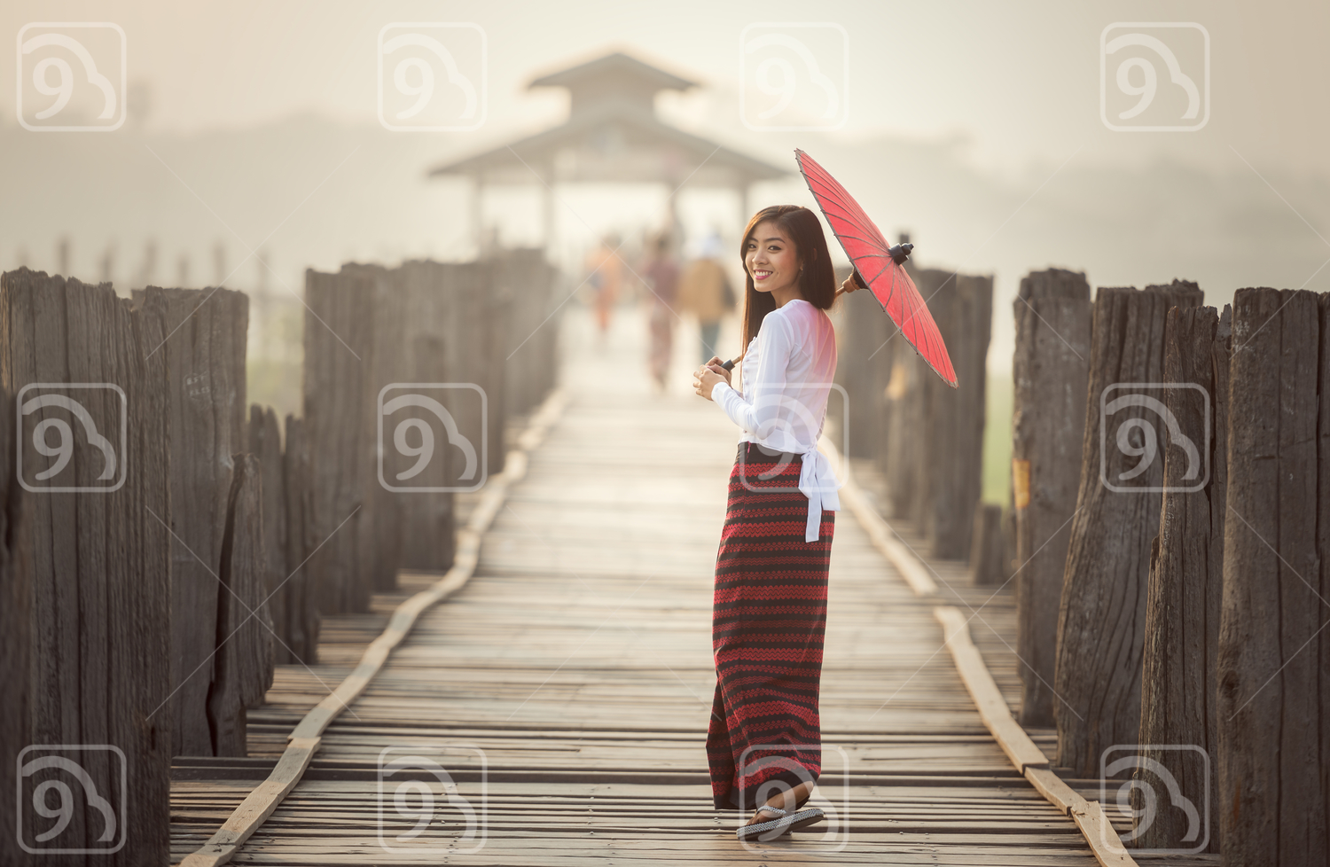 Burmese woman holding traditional