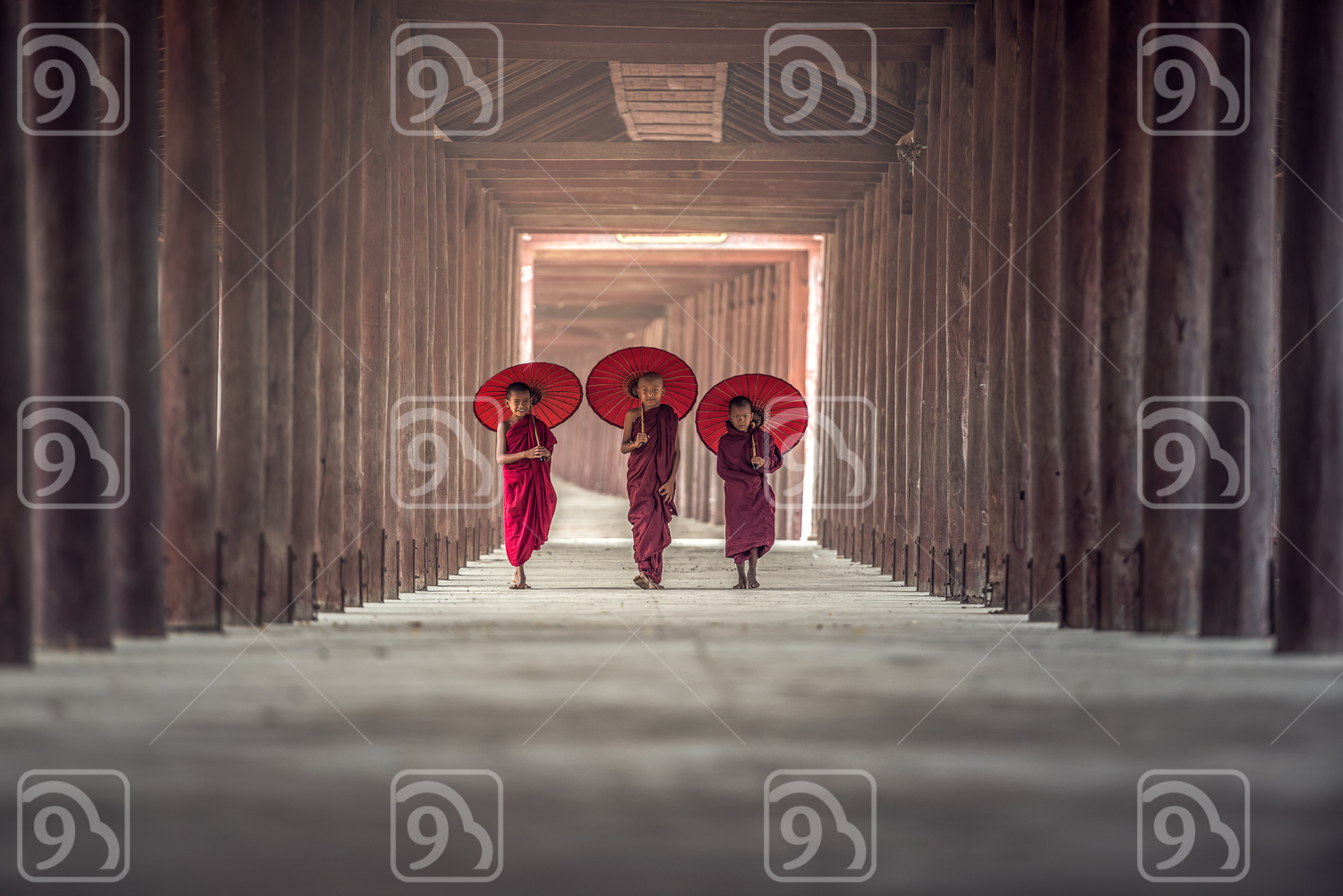 Buddhist novice walking in temple