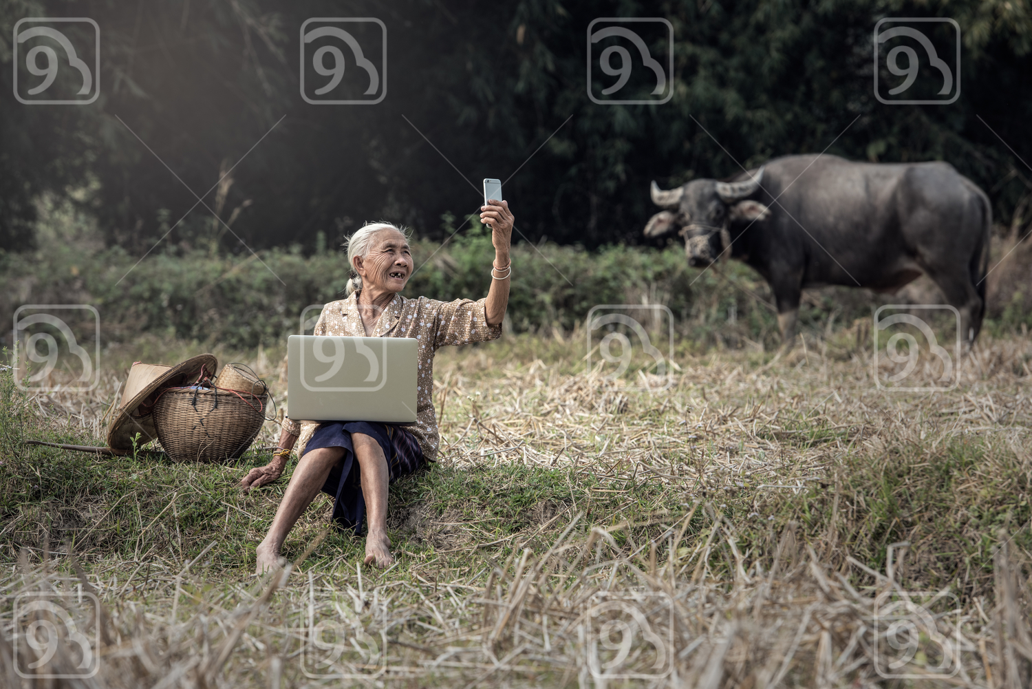Grandmother taking a selfie in the countryside of Thailand