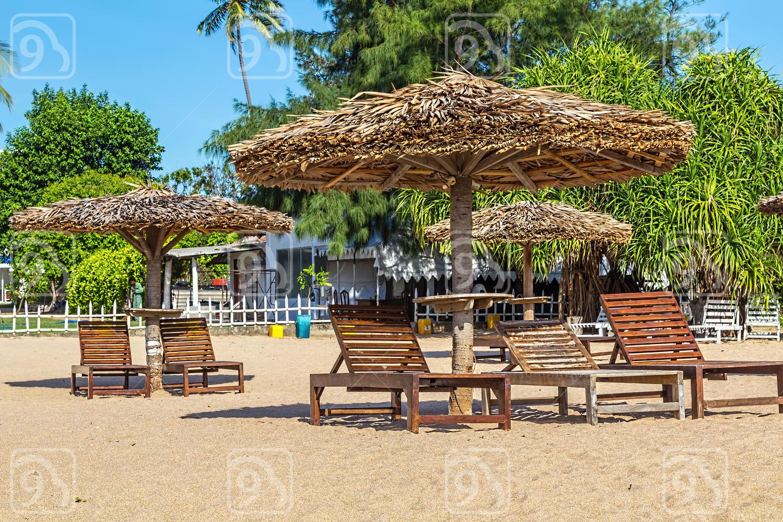 Sunbeds on a tropical sandy beach on the shores of the Indian Ocean. Sri Lanka