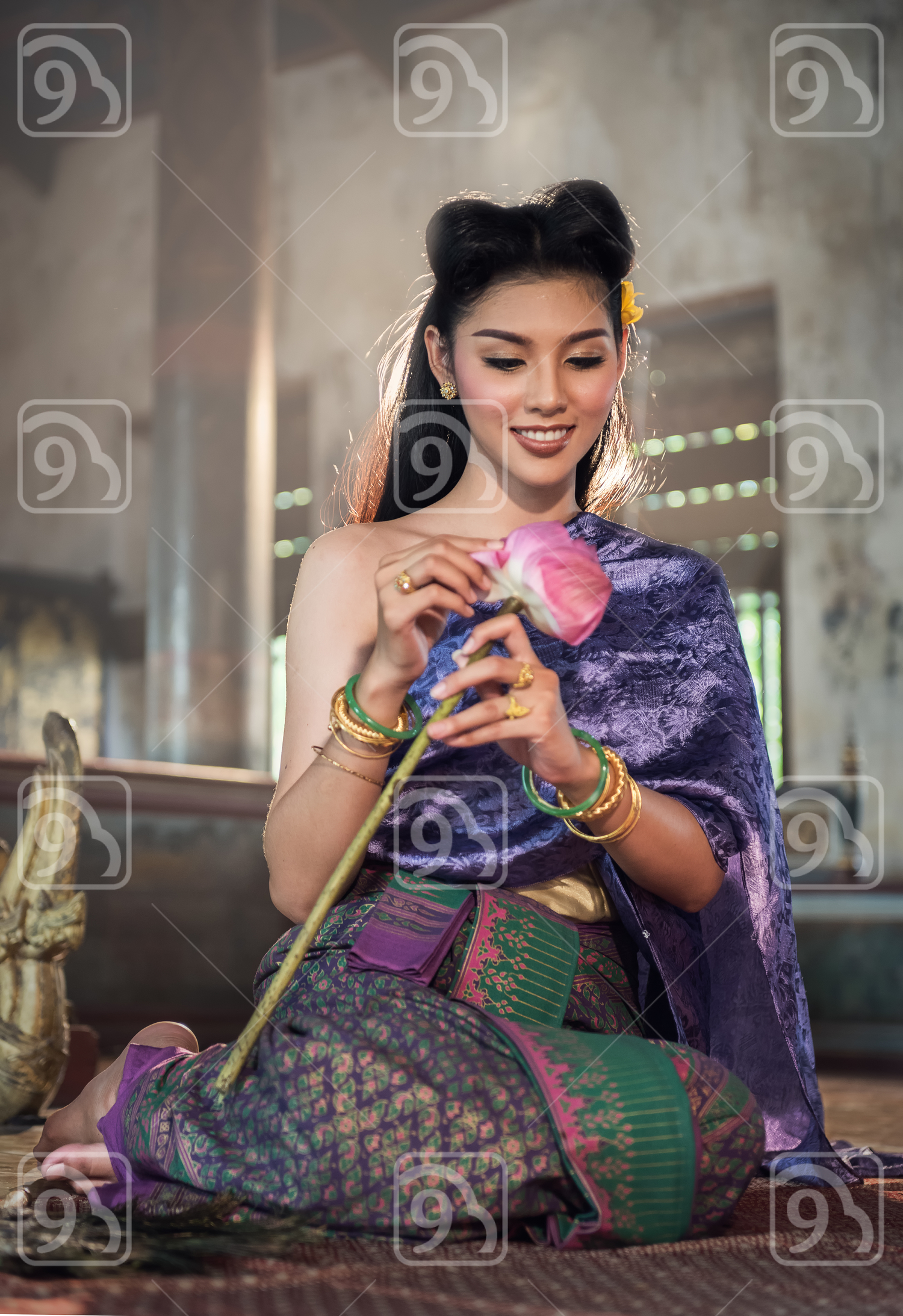 Thai girl making lotus flower in temple
