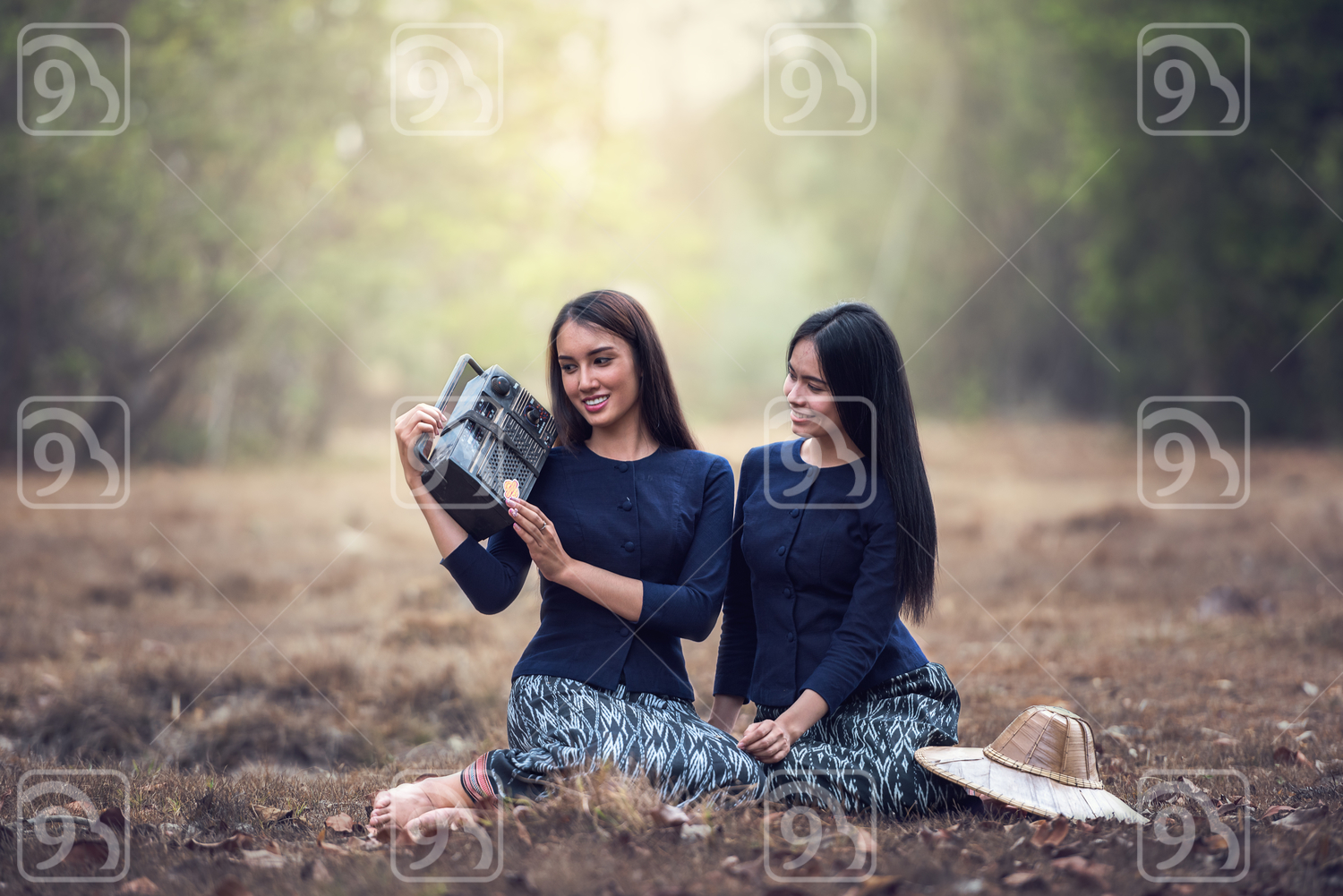Woman Holding Radio in grass field