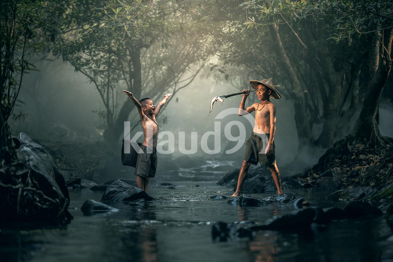 Two boy fishing in creeks