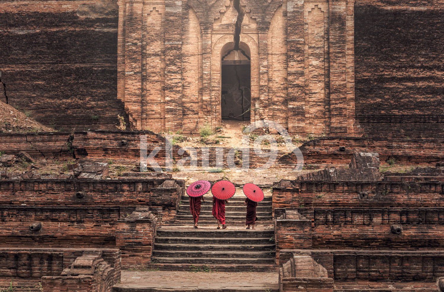 Buddhist novice are walking in temple