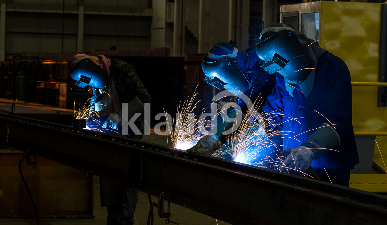 worker with protective mask welding