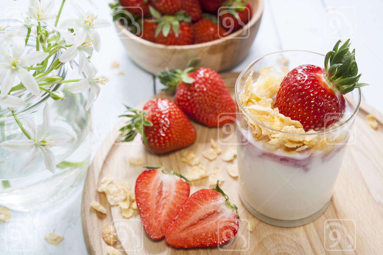 Yogurt with fresh strawberry and corn flakes