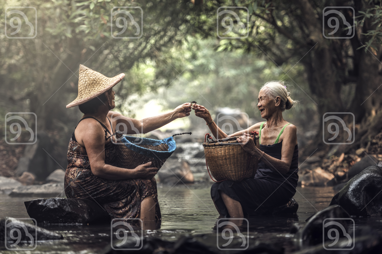 Thai villagers doing laundry in a river in Thailand