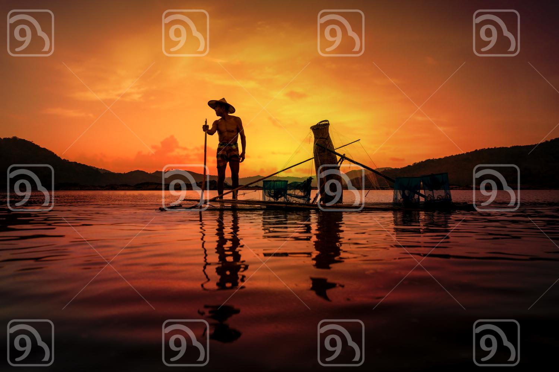 Fisherman hard at work during sunset