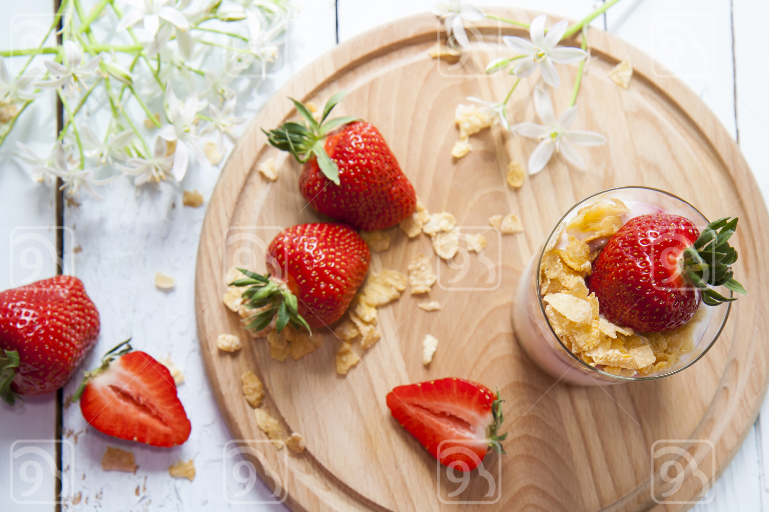 Yogurt with fresh strawberry and corn flakes
