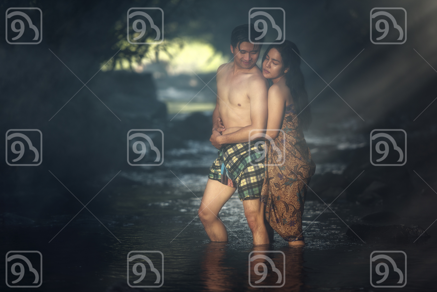 Asian couple bathing in a river