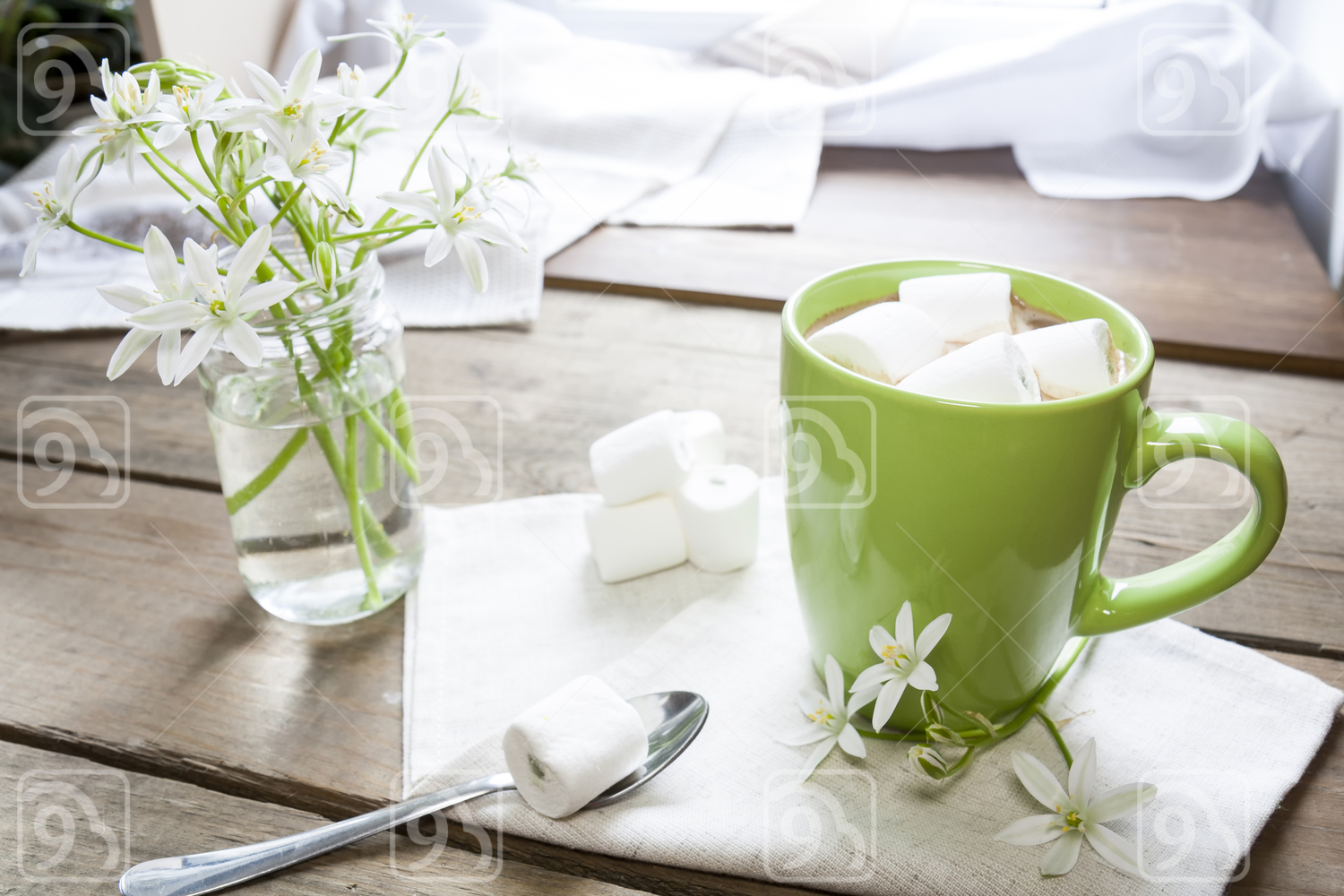 Hot cocoa with marshmallows in green cup