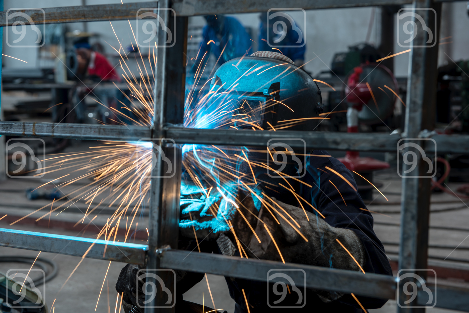 Industrial Worker welding in a factory