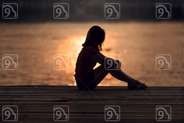 Sad woman silhouette worried