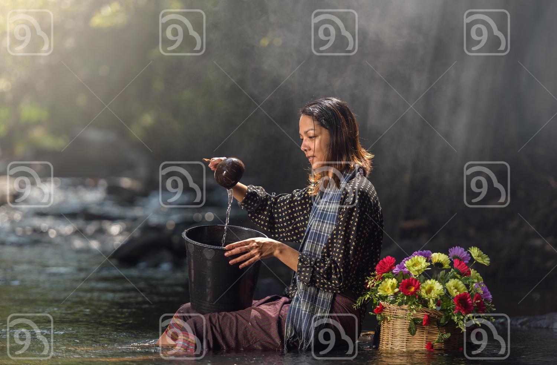 Asian woman in cascade