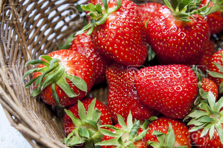 Fresh Strawberries in wicker basket