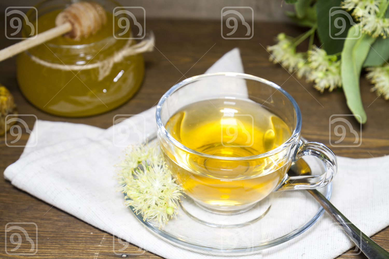 Linden tea in glass cup and jar with honey
