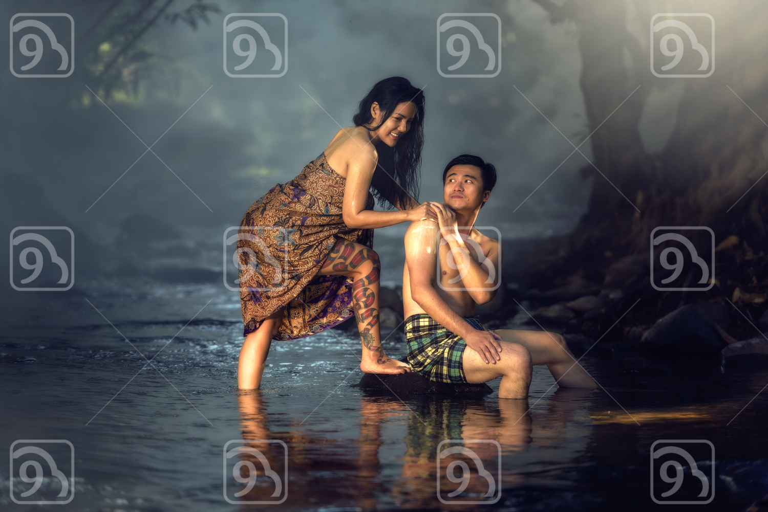 Asian couple bathing in the river