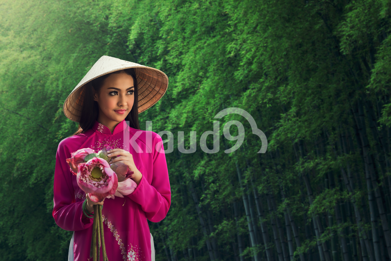 Portrait of beautiful Vietnamese girl in traditional dress