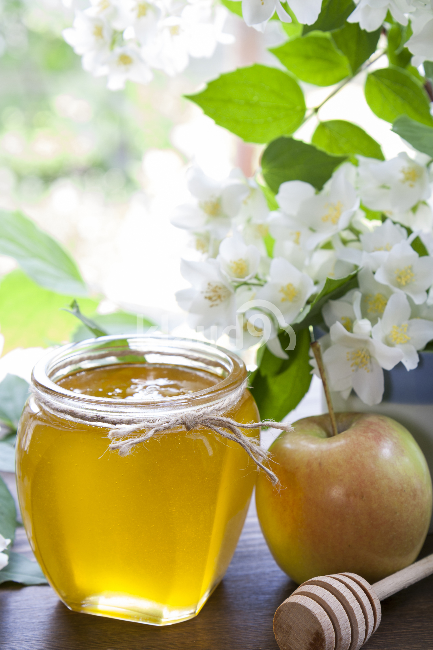 Delicious fresh spring honey in glass jar