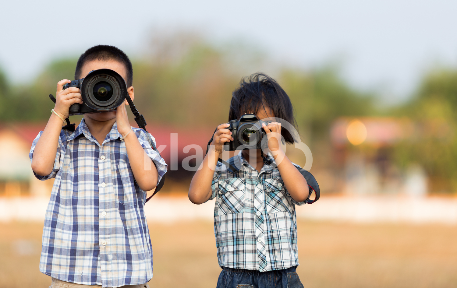 Cute children holding cameras