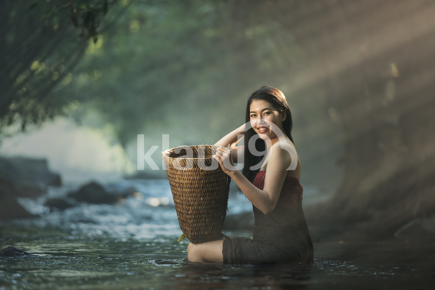 Asian sexy woman bathing in cascade