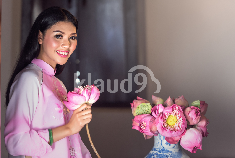 Portrait of smiley Vietnamese girl in traditional dress