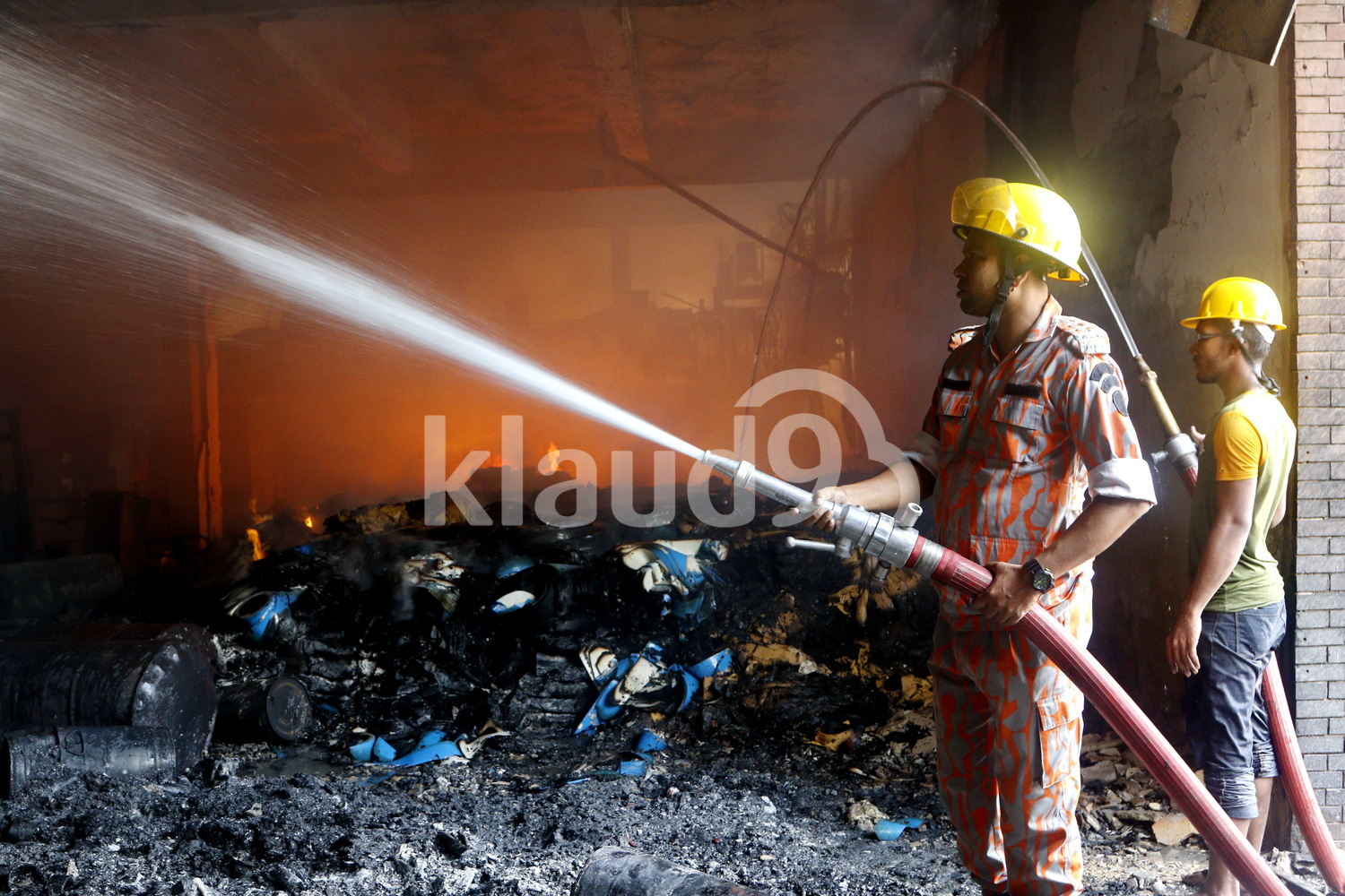 Firemen at Bangladesh factory fire