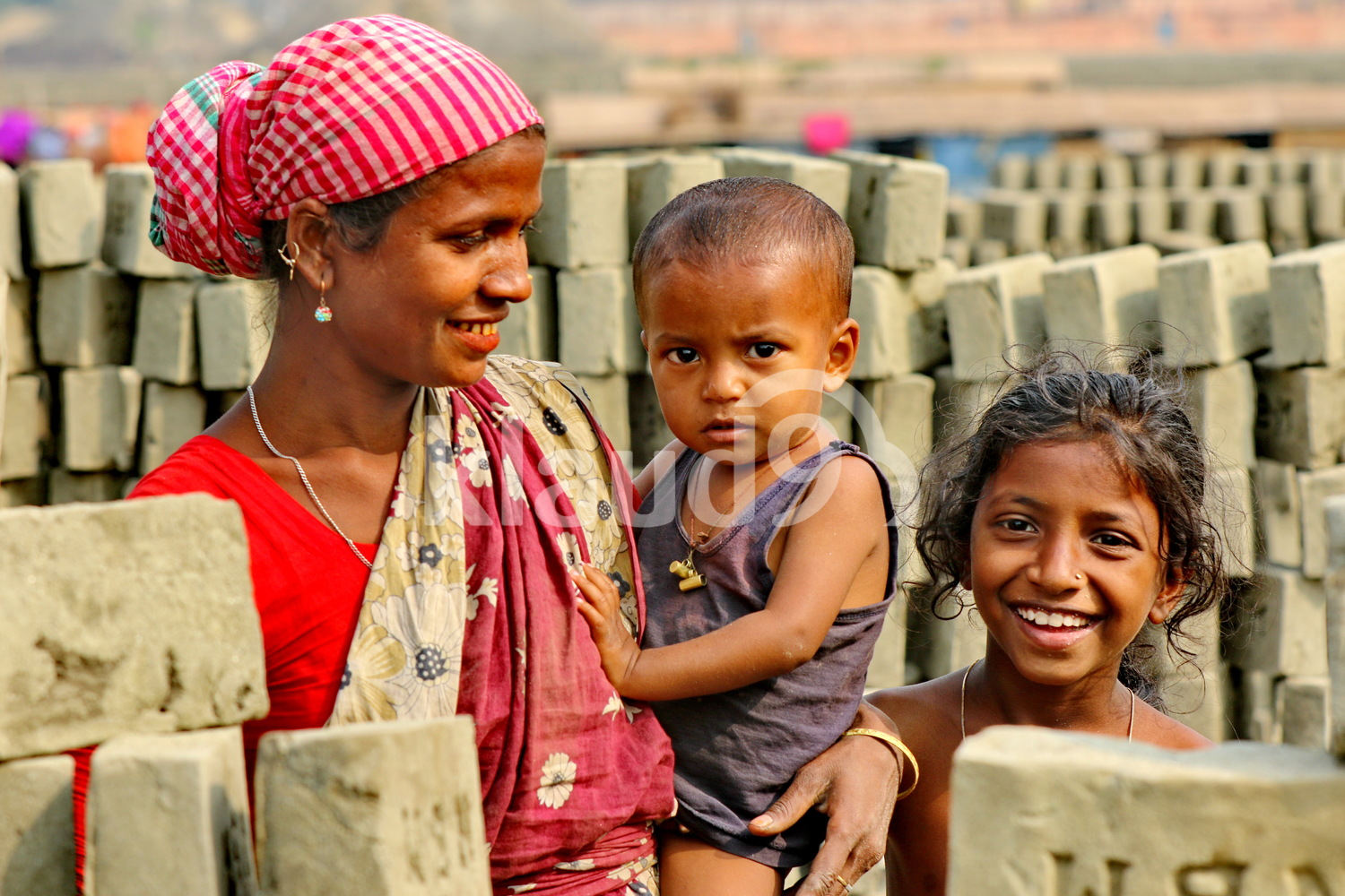 Female worker and her children in Bangladesh