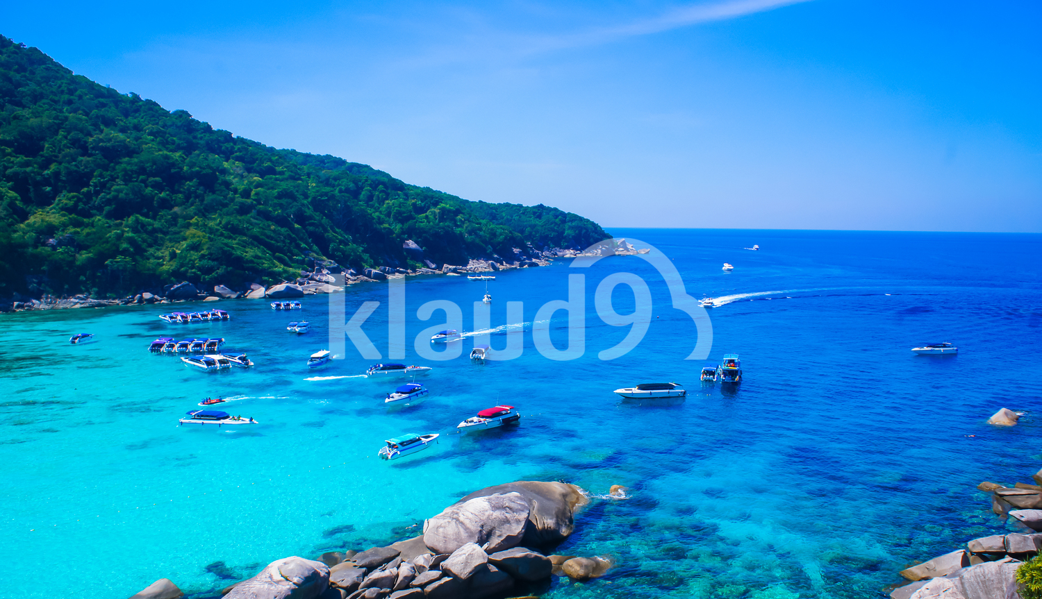 Beautiful crystal clear blue sea with groups of yachts