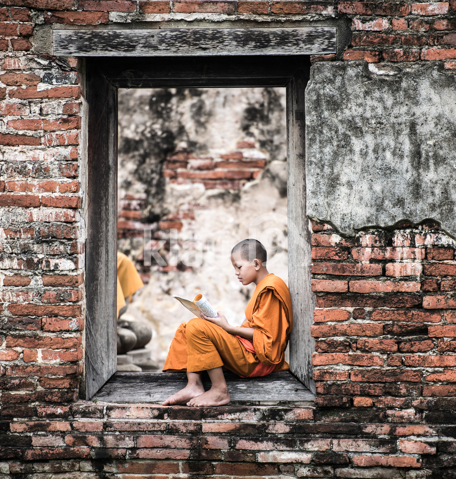 Southeast Asian Novice monk reading book