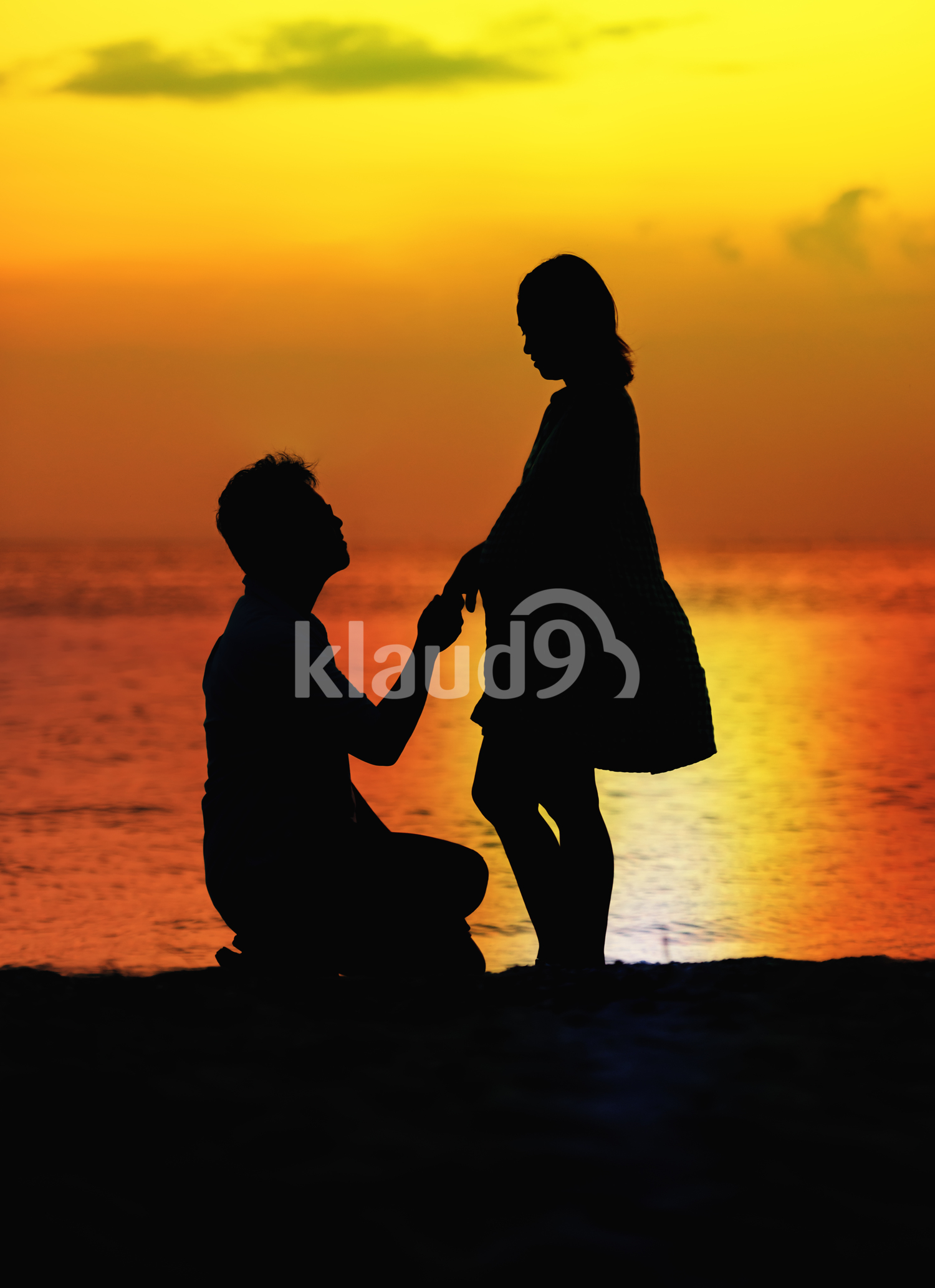 Pregnant couple sunset silhouette