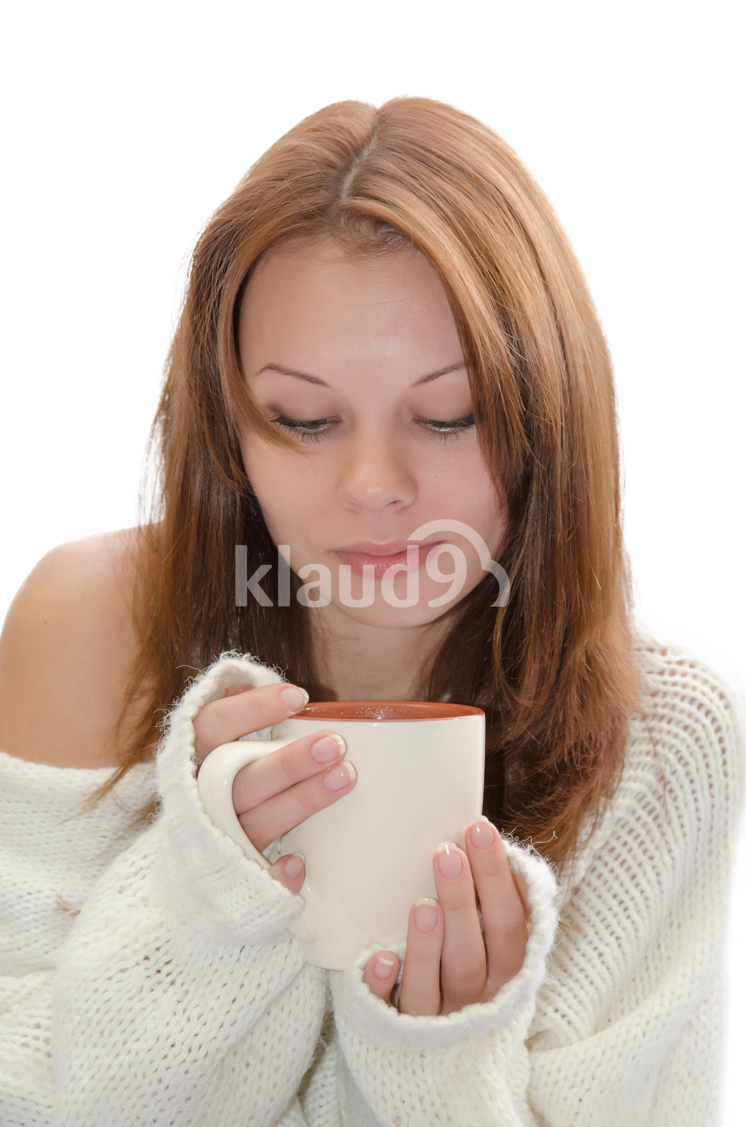 Woman about to sip her drink