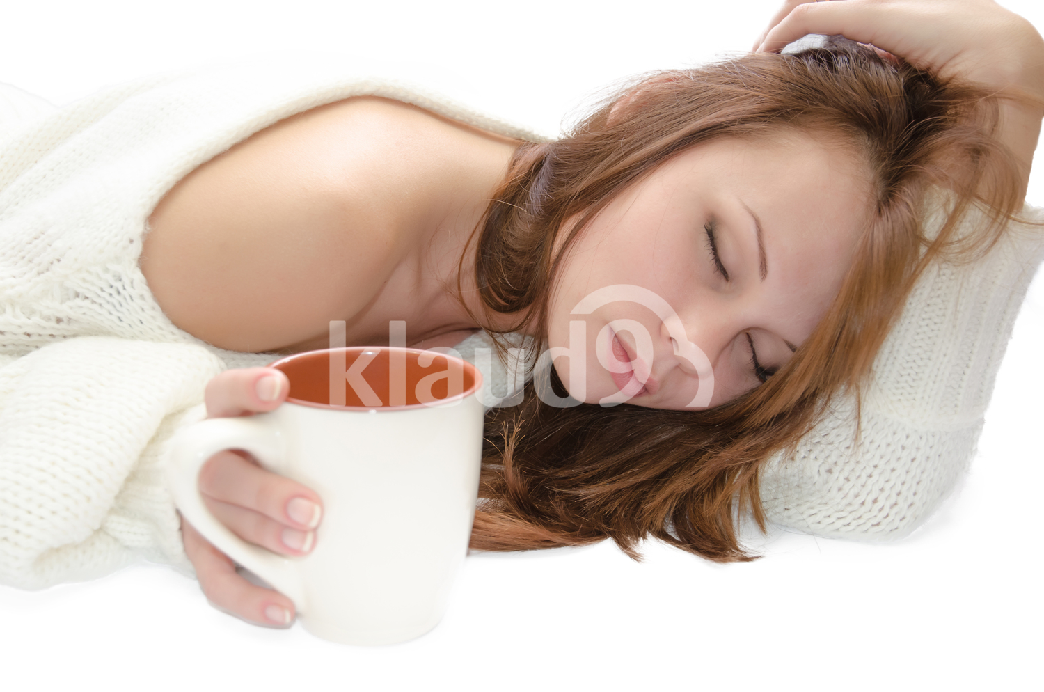 Woman sleeping with a cup