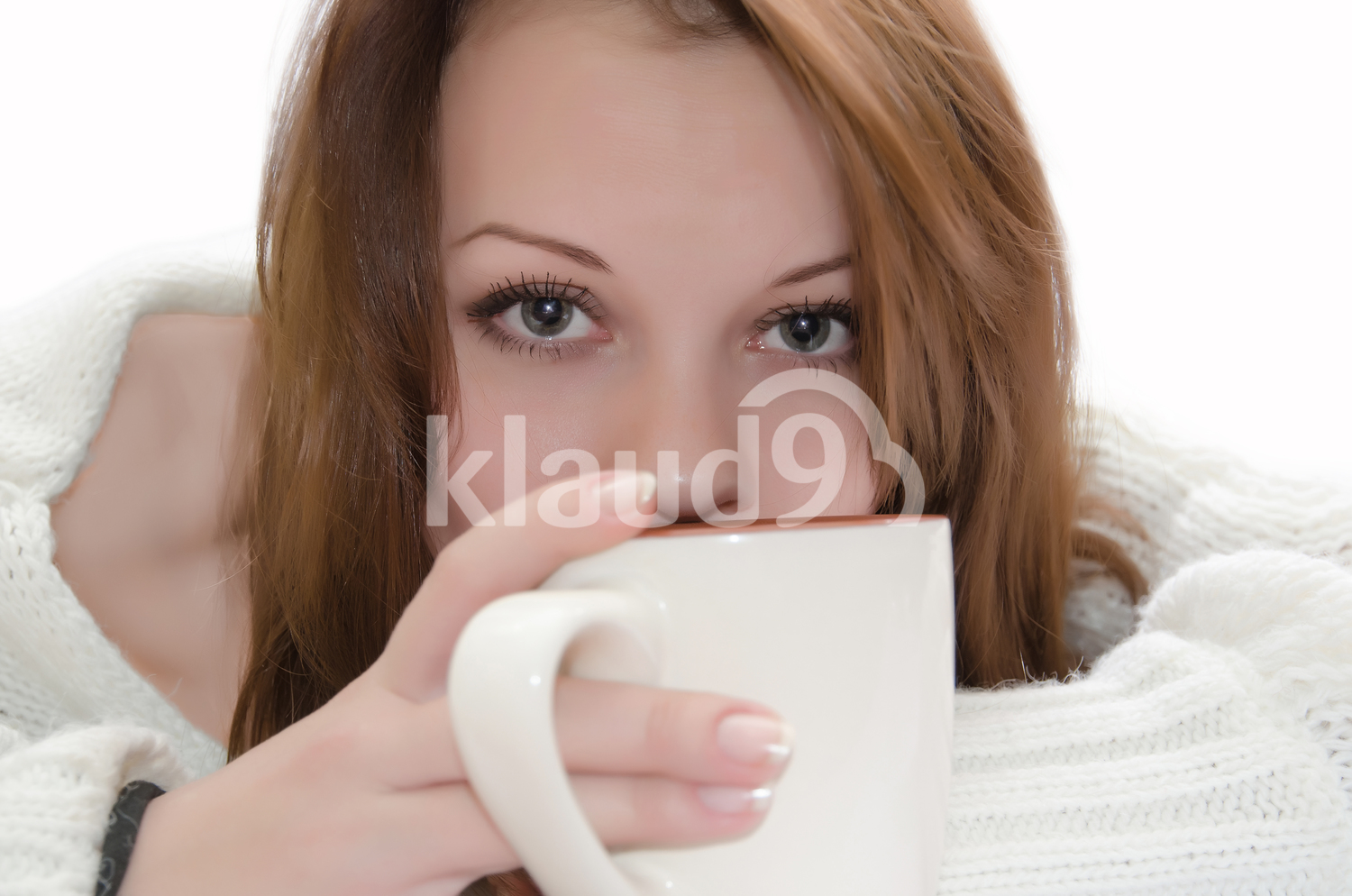 Woman with a cup covering her face
