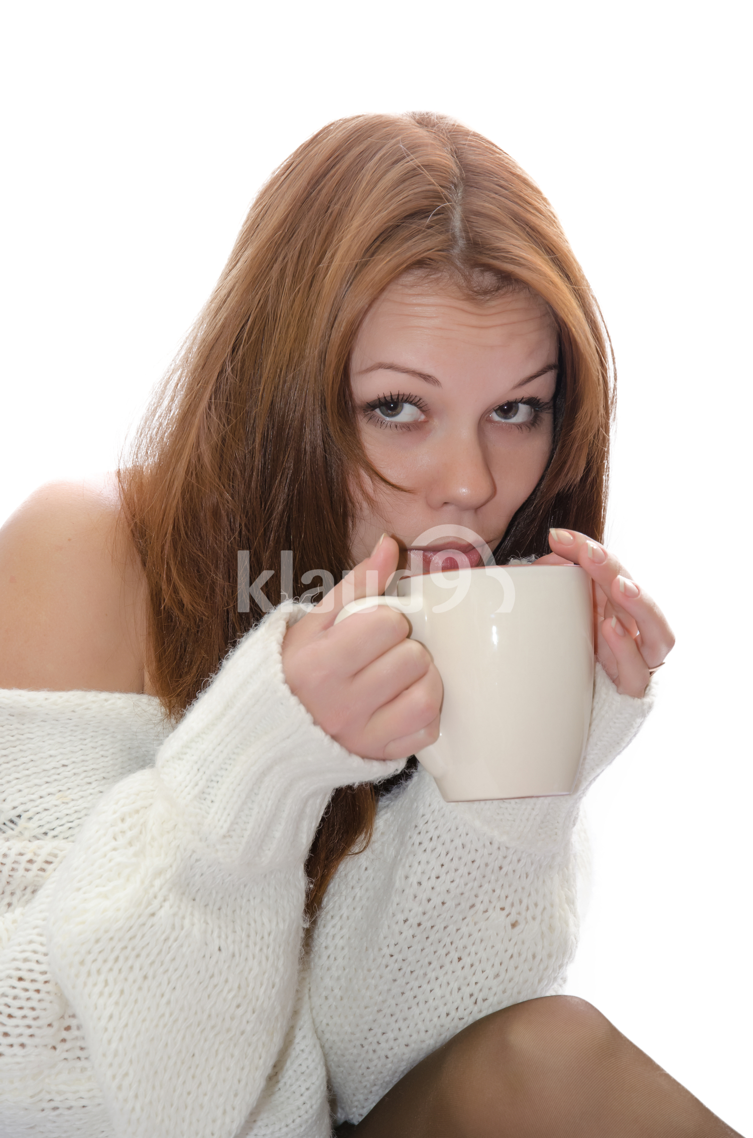 Woman sipping from a cup