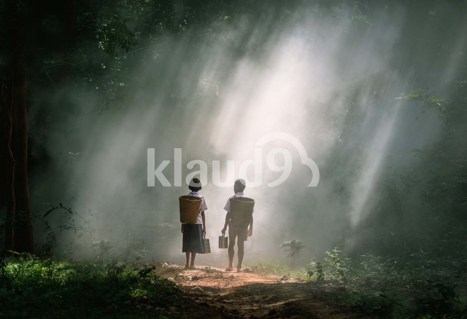 Young Thais hiking in forest