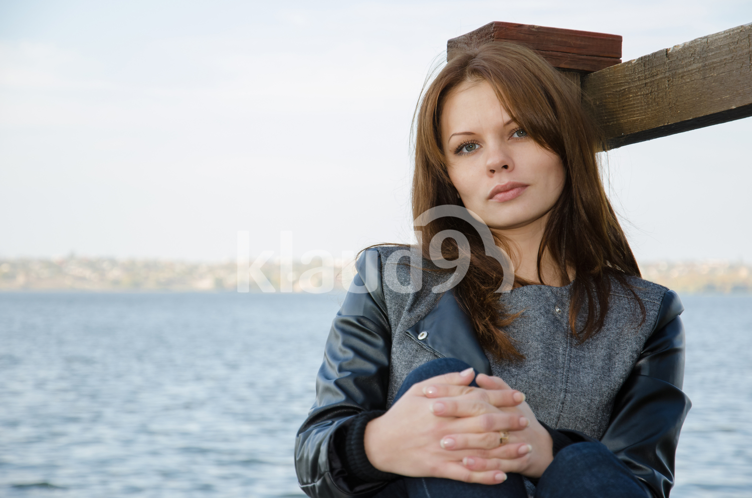 Woman on a river dock looking into the camera