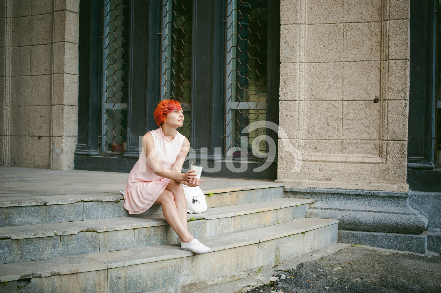 Woman looking forlorn with a coffee cup