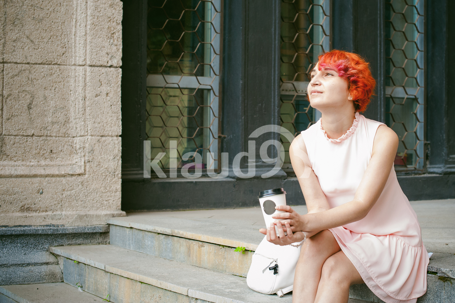 Red haired woman lost in her thoughts