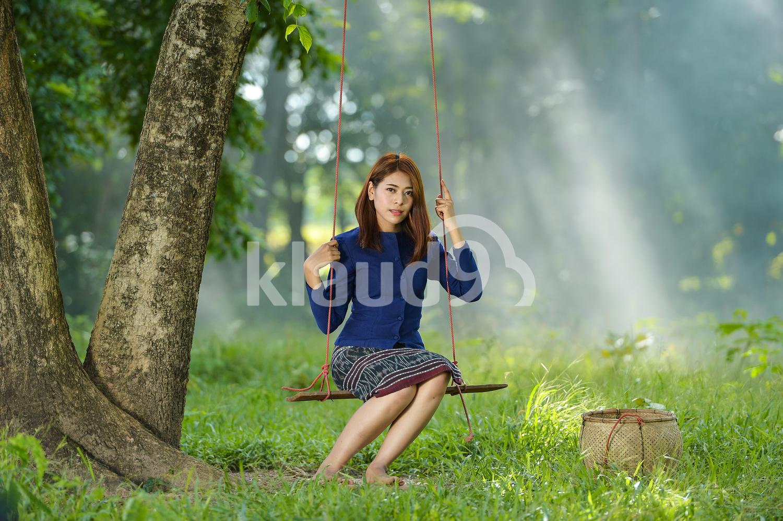 Thai woman on a swing