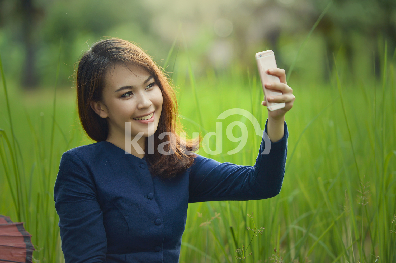 Thai female villager shooting a selfie