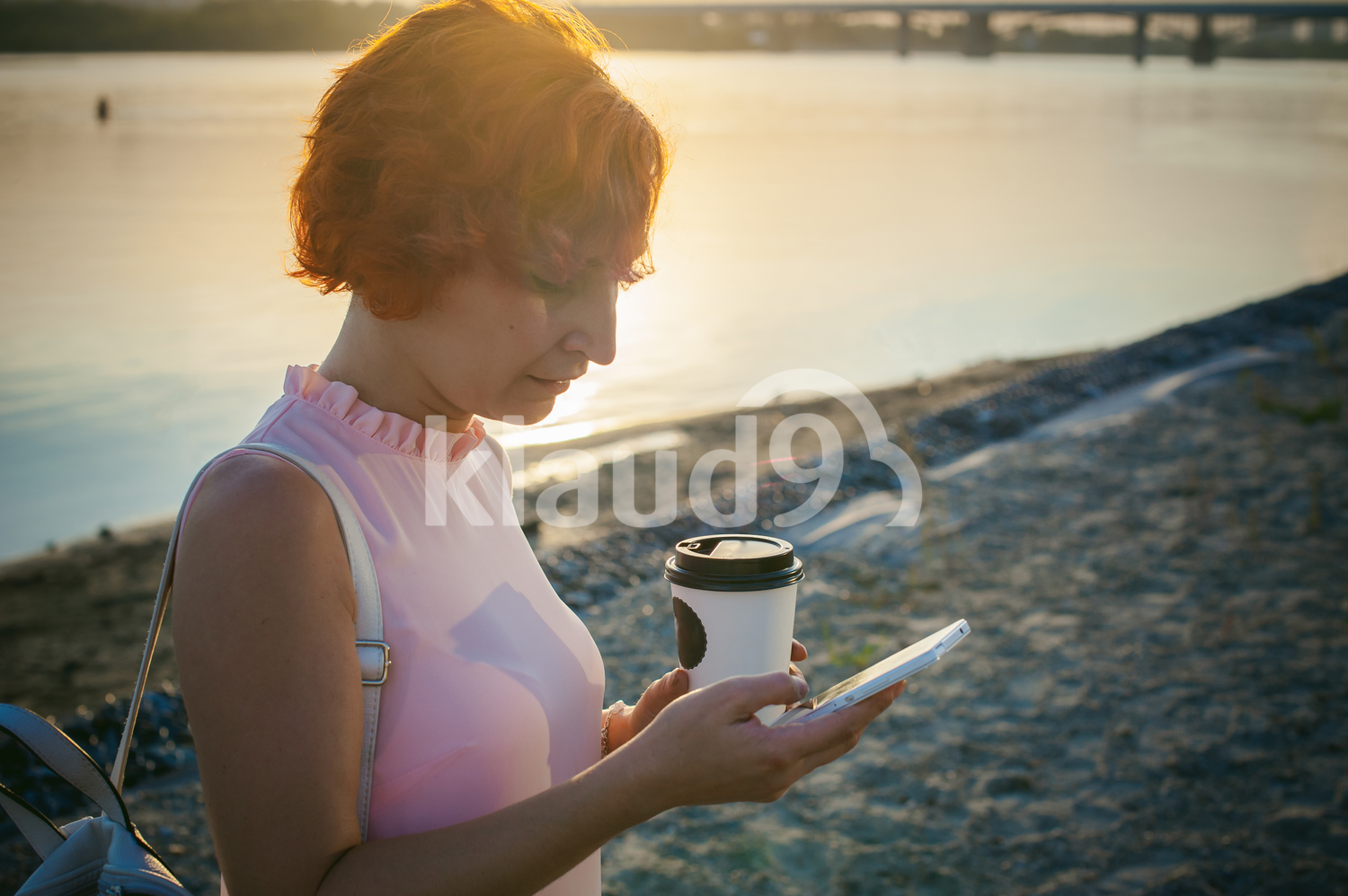 Female with red hair texting on her cell phone