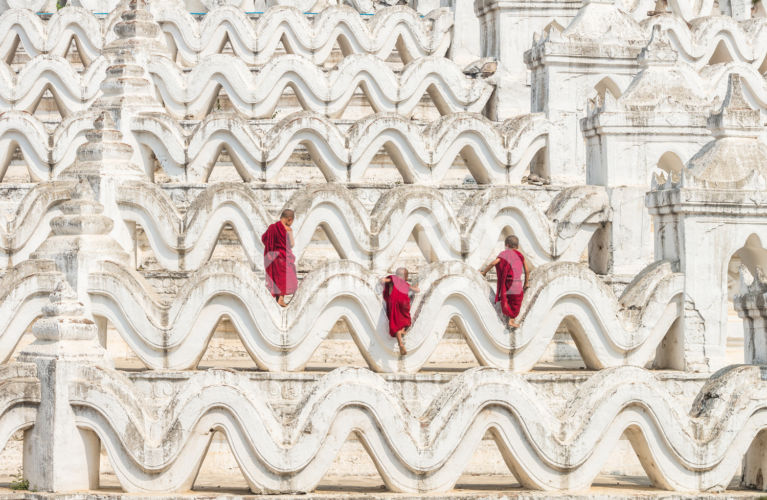 Back view of three monks on Mya Thein Tan Pagoda