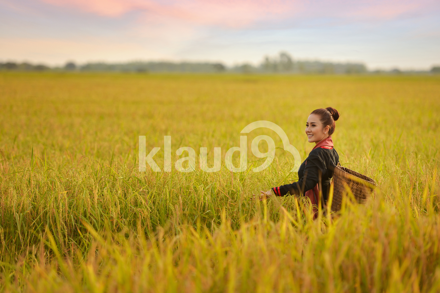 Beautiful Thai local woman working in the fields